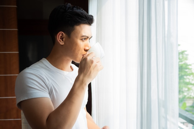 Young man drink coffee at home