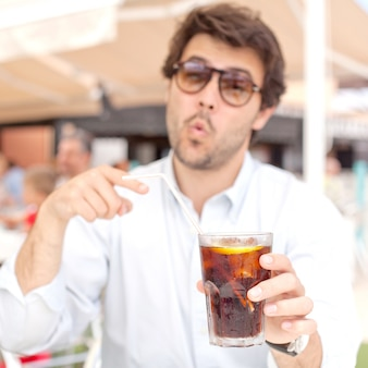Young man drinking a beverage