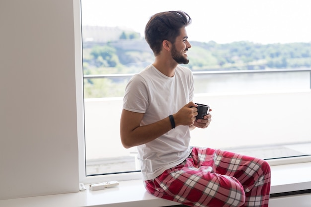 Young man drinking coffee in the morning