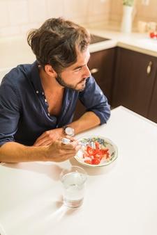 Young man eating healthy salad