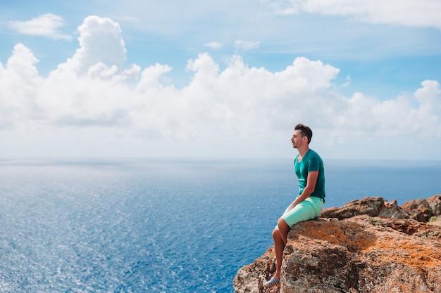 Young man enjoying breathtaking views of beautiful landscape
