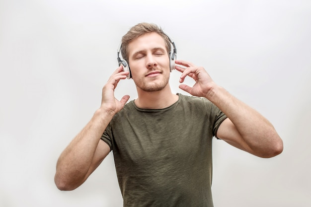 Young man enjoying listening to music