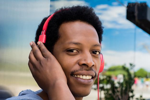 Young man enjoying music outdoor