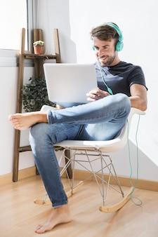Young man enjoying music with earphones