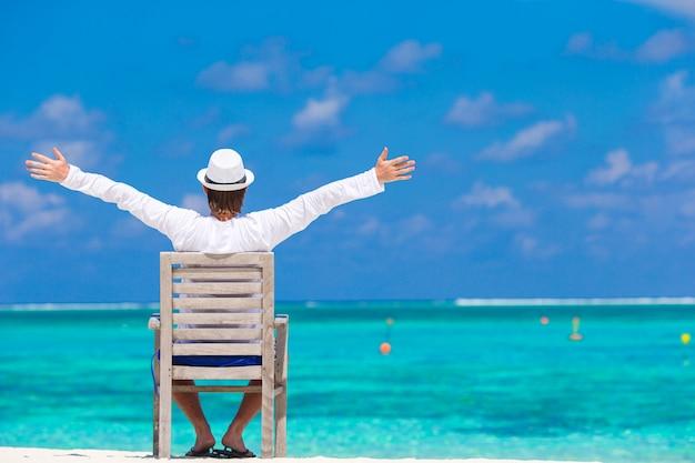 Young man enjoying summer vacation on tropical beach