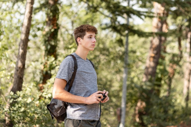 Young man enjoying walk in the forrest