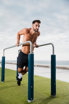 Young man exercising routine outdoor