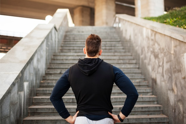 Young man exercising in urban environment