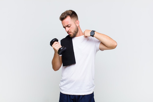 Young man feeling stressed, anxious, tired and frustrated, pulling shirt neck, looking frustrated with problem