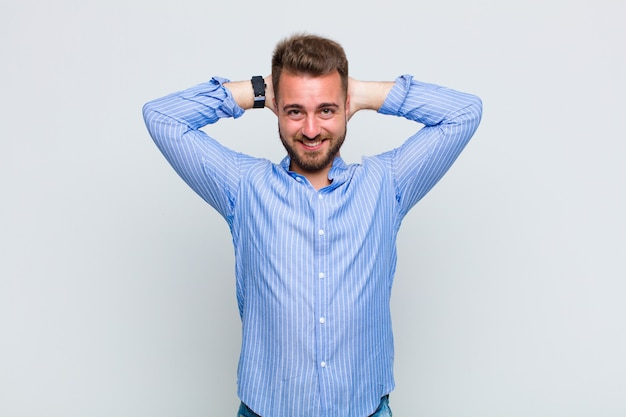 Young man feeling stressed, worried, anxious or scared, with hands on head, panicking at mistake
