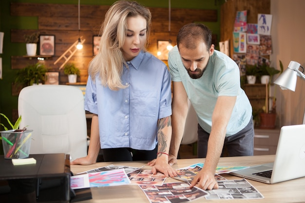 Young man and female fashion designers looking for inspiration to make a new line of dresses.