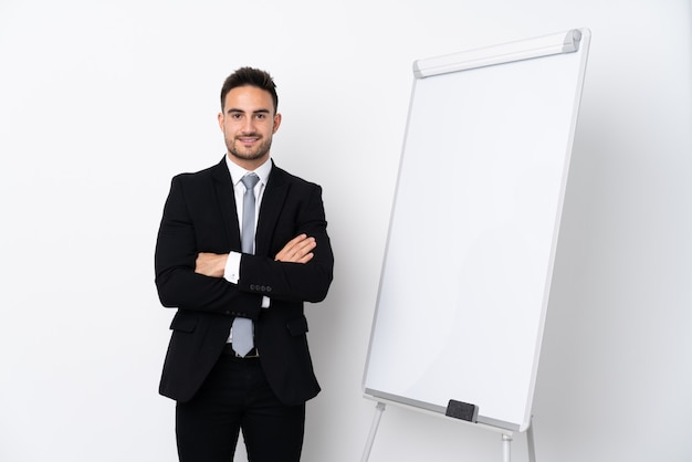 Young man giving a presentation on white board and smiling