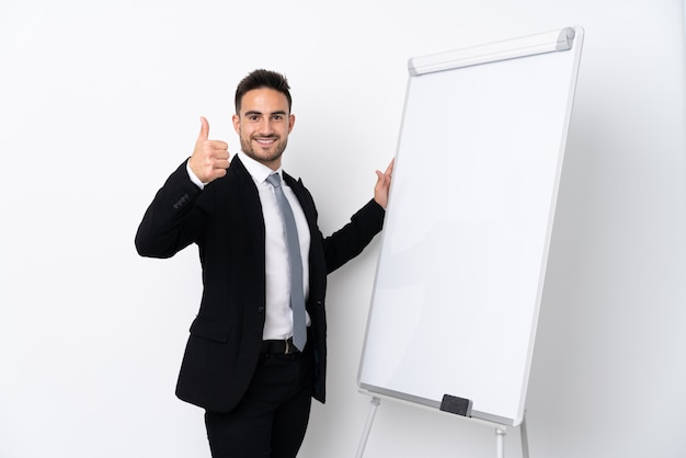 Young man giving a presentation on white board with thumb up