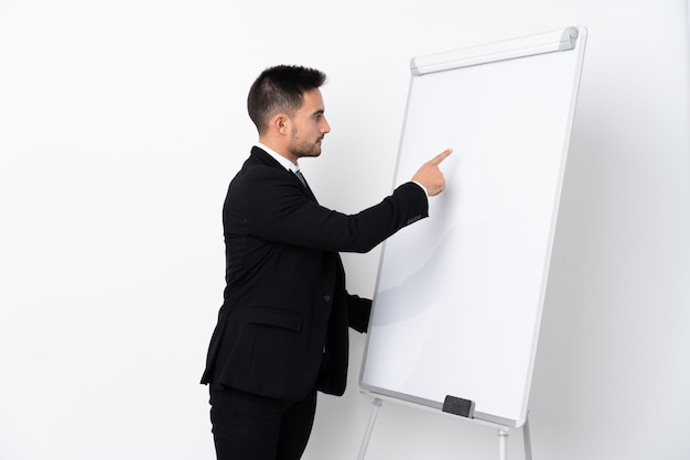 Young man giving a presentation on white board
