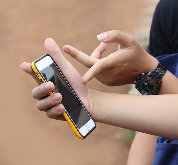 Young man hand hold phone
