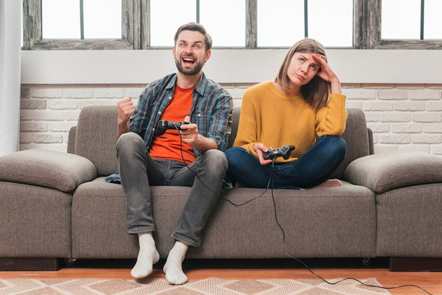 Young man having fun playing video console games together