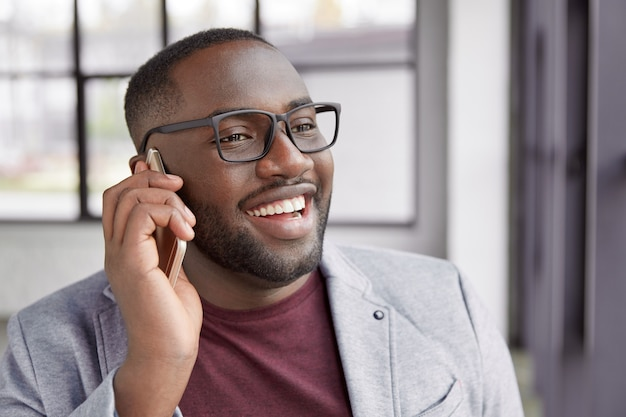 Young man having phone conversation