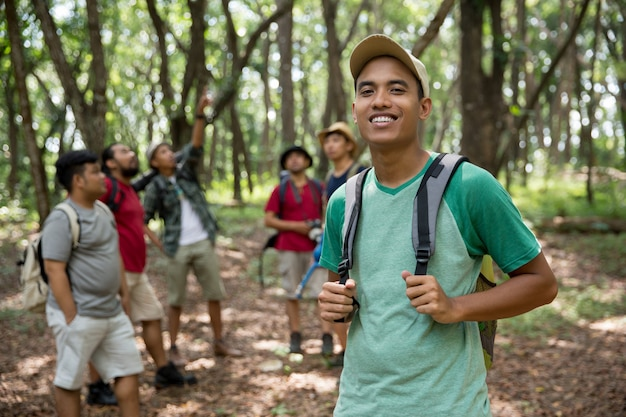 Young man hiker smiling