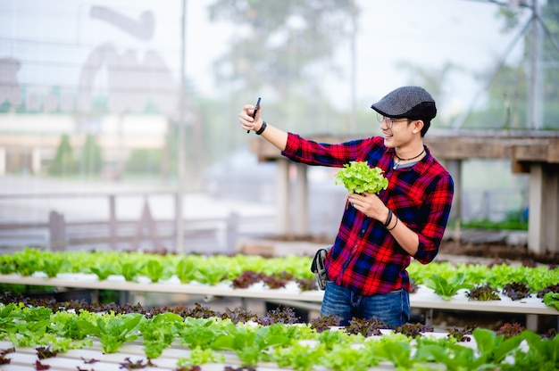The young man and his salad garden and his happy smile