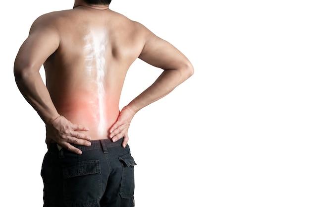 흰색 표면에 허리 통증 뼈 척추를 잡고 젊은 남자