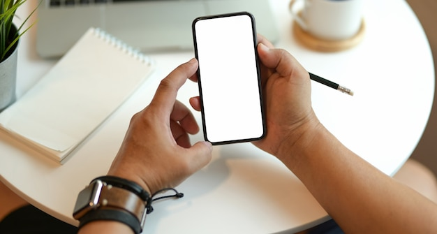 Young man holding blank screen smartphone
