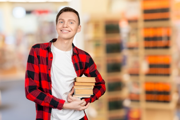 Young man holding books