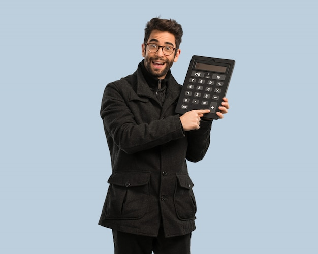 Young man holding a calculator