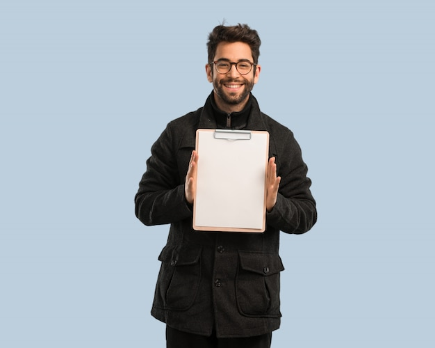 Young man holding a file cabinet