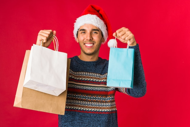 Young man holding a gift on christmas day