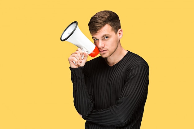 The young man holding a megaphone