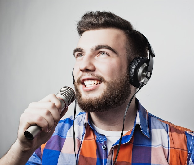 Young man holding a microphone