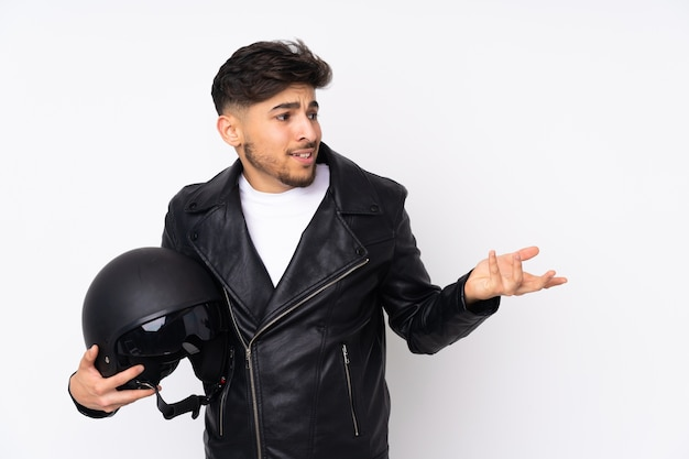 Young man holding a motorcycle helmet