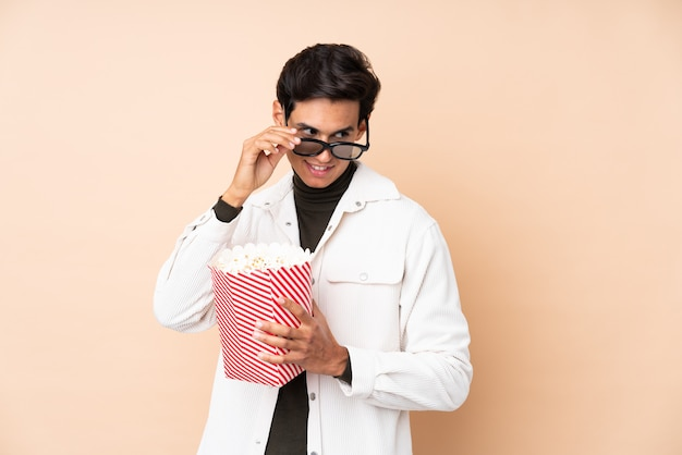 Young man holding a popcorns