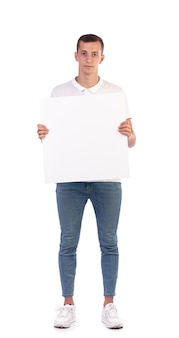 Young man holding a sign or poster isolated