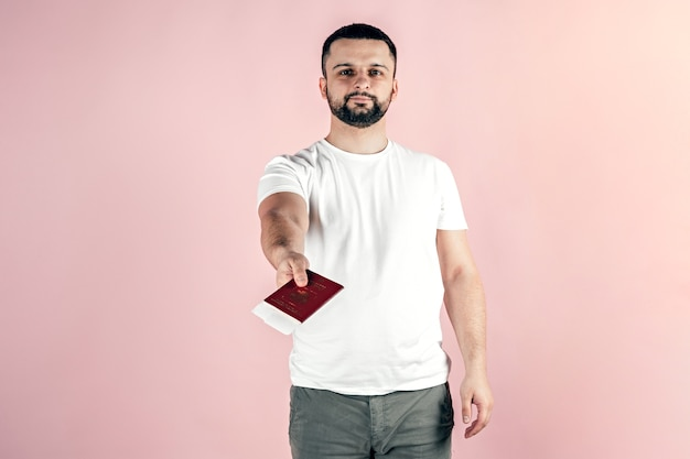 A young man holds a passport in his hands. travel, emigration, vacation.