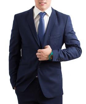 Молодой человек в костюме изолированном на белизне