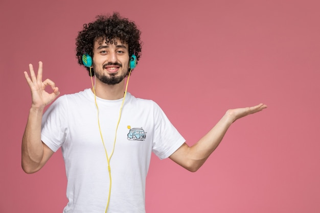 Young man is doing well with white t-shirt
