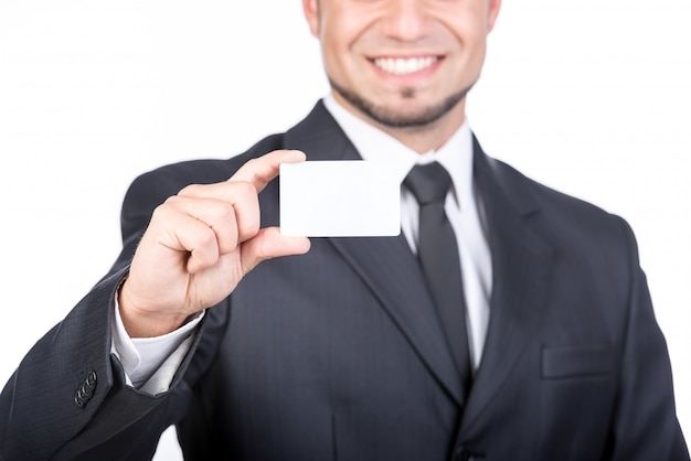 Young man is holding a business card.