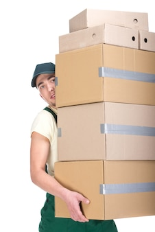 Young man is holding cardboard boxes