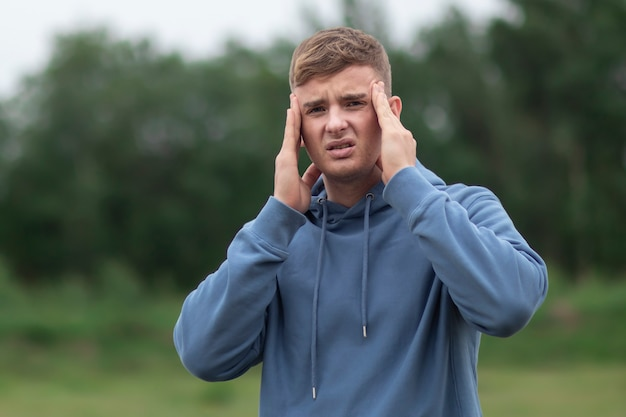 Young man is suffering from headache