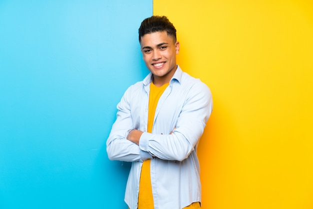 Young man over isolated colorful