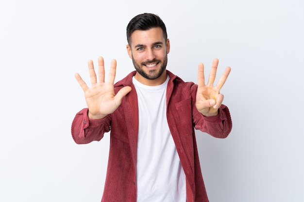 Young man over isolated white wall