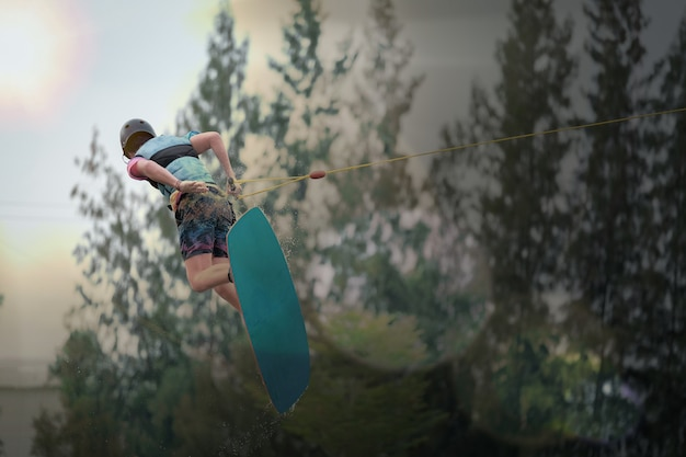 The young man jump while wakeboarding. extreme sports for fun.