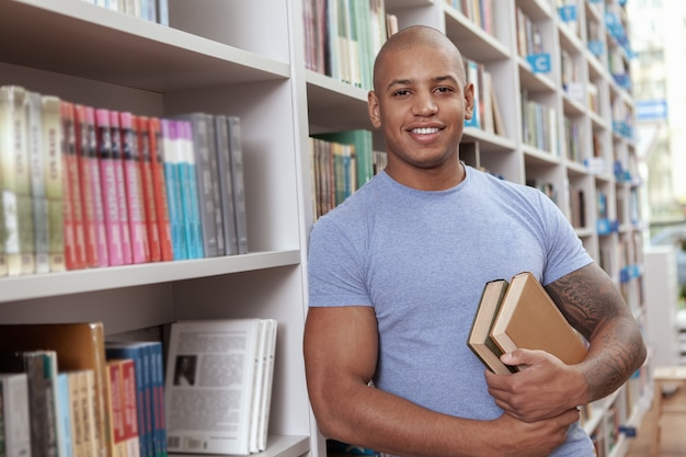 Young man at the library or bookstore
