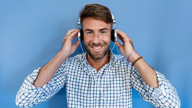 Young man listening music with earphones