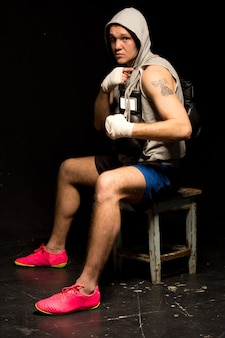 Young man looking boxer waiting for a fight