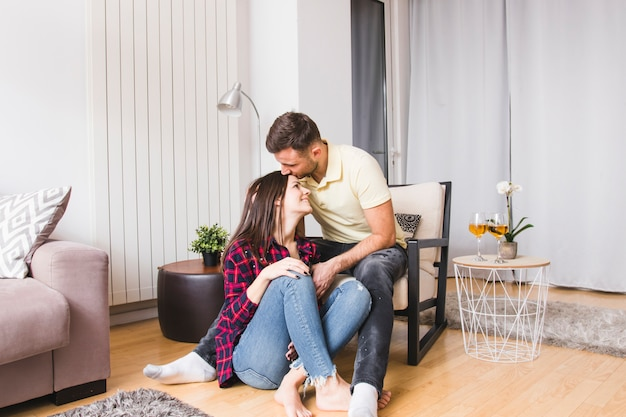 Young man loving his girlfriend at modern home
