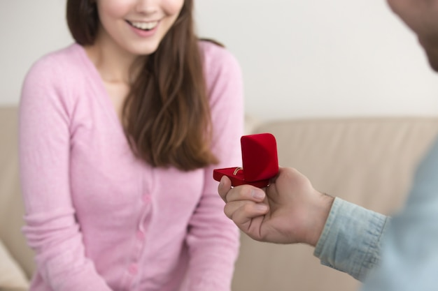 Young man making marriage proposal to girlfriend