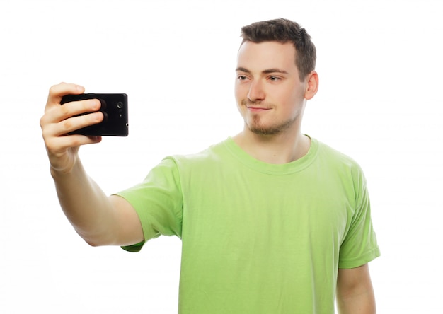 Young man making photo of himself