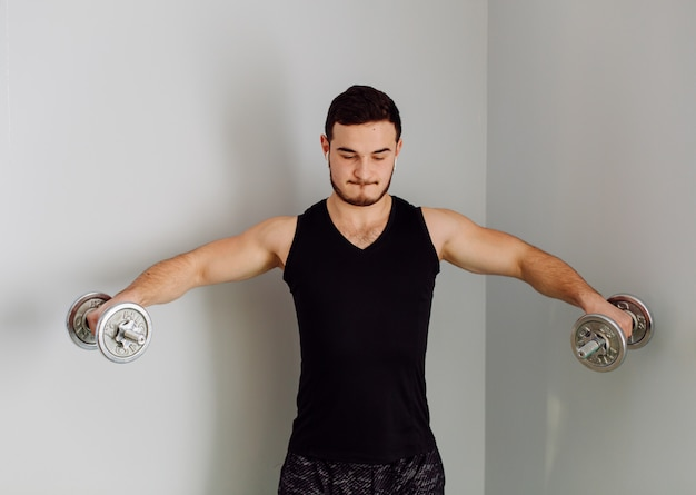 Young man making sport exercises at home